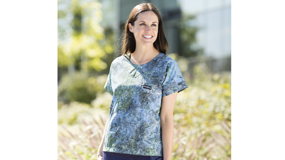 Womens floral print scrub top with navy scrub pants